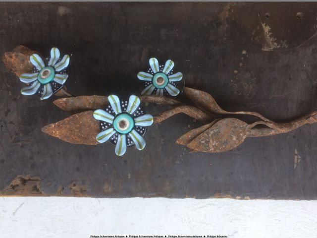 a 19th century wrought iron branch with leaves and ceramic flowers by artist Anna-Iris Luneman for sell